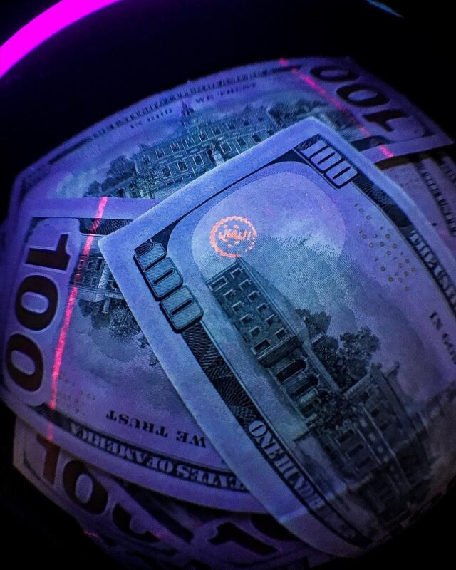 fake money that looks and feels real,